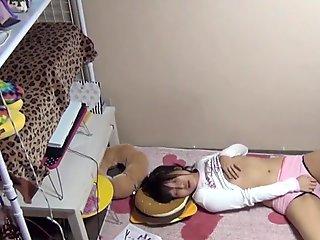 Japanese female masturbates while taped by voyeur