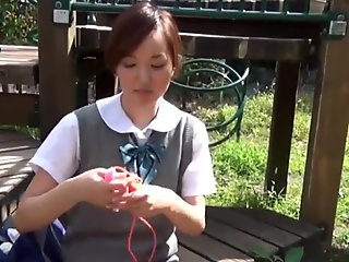 Asian teenager rides toy